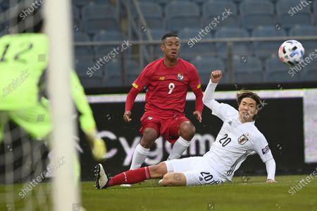 Gabriel Torres of Panama (C) and Kou Itakura of Japan (R) in action during the international friendly match between Japan and Panama in Graz, Austria, 13 November 2020.