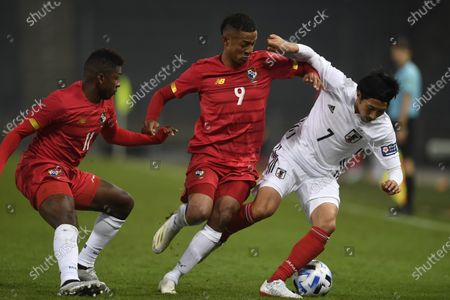Stock Picture of Japan's Gaku Shibasaki, right, tries to keep the ball as Panama's Gabreil Torres, center, and Armando Cooper defend during the international friendly soccer match between Japan and Panama at Merkur-Arena stadium in Graz, Austria
