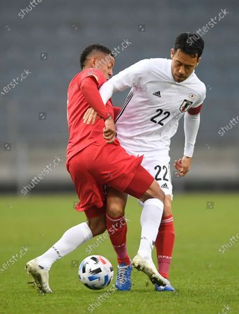 Japan's Maya Yoshida, right, and Panama's Gabriel Torres fight for the ball during the international friendly soccer match between Japan and Panama at Merkur-Arena stadium in Graz, Austria