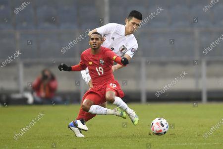Japan's Naomichi Ueda, background, stops stops Panama's Cesar Yanis during the international friendly soccer match between Japan and Panama at Merkur-Arena stadium in Graz, Austria