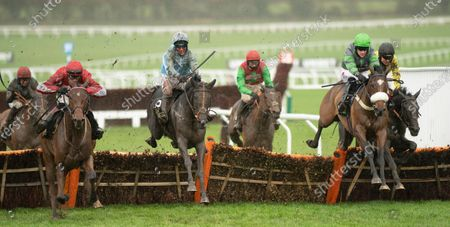 The Shunter (Robbie Power, blue, centre) jumps the final flight and wins the Greatwood HurdleCheltenham 15.11.20 Pic: Edward Whitaker, supplied by Hugh Routledge.