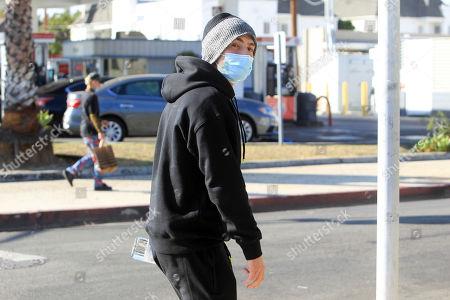 Stock Photo of Gregg Sulkin is seen taking a walk.