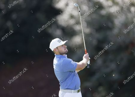 Stock Photo of Tyrrell Hatton of England hits from the fairway on the thirteenth hole during the second round of the 2020 Masters Tournament at the Augusta National Golf Club in Augusta, Georgia, USA, 13 November 2020. After being delayed seven months by the coronavirus pandemic, the 2020 Masters Tournament is being held without patrons 12 November through 15 November.