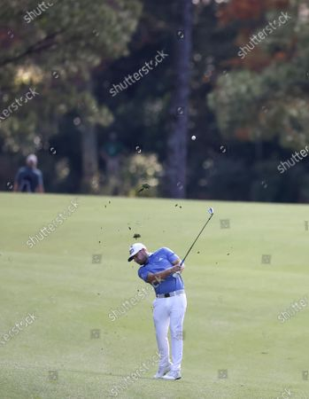 Stock Image of Tyrrell Hatton of England hits from the fairway on the thirteenth hole during the second round of the 2020 Masters Tournament at the Augusta National Golf Club in Augusta, Georgia, USA, 13 November 2020. After being delayed seven months by the coronavirus pandemic, the 2020 Masters Tournament is being held without patrons 12 November through 15 November.
