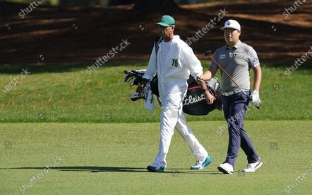 Sungjae Im of South Korea and his caddie Robert Gregory Brown on the fifteenth hole during the second round of the 2020 Masters Tournament at the Augusta National Golf Club in Augusta, Georgia, USA, 13 November 2020. After being delayed seven months by the coronavirus pandemic, the 2020 Masters Tournament is being held without patrons 12 November through 15 November.