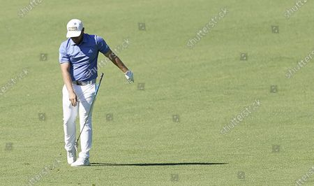 Stock Picture of Tyrrell Hatton of England throws his club after hitting from the fairway on the second hole during the second round of the 2020 Masters Tournament at the Augusta National Golf Club in Augusta, Georgia, USA, 13 November 2020. After being delayed seven months by the coronavirus pandemic, the 2020 Masters Tournament is being held without patrons 12 November through 15 November.