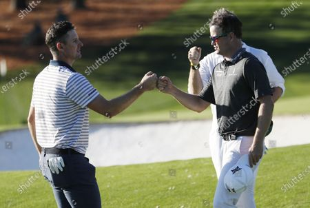Justin Rose of England (L) and Zach Johnson of the US (R) bump fists after finishing their round on the ninth hole during the second round of the 2020 Masters Tournament at the Augusta National Golf Club in Augusta, Georgia, USA, 13 November 2020. After being delayed seven months by the coronavirus pandemic, the 2020 Masters Tournament is being held without patrons 12 November through 15 November.
