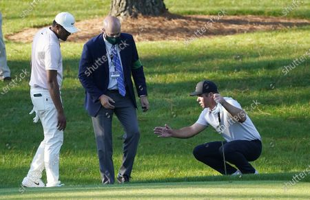 Paul Casey of England (R) talks with a rules official on the seventh hole during the second round of the 2020 Masters Tournament at the Augusta National Golf Club in Augusta, Georgia, USA, 13 November 2020. After being delayed seven months by the coronavirus pandemic, the 2020 Masters Tournament is being held without patrons 12 November through 15 November.