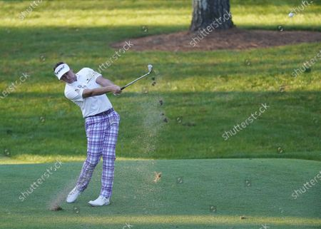 Ian Poulter of England hits from the fairway on the seventh hole during the second round of the 2020 Masters Tournament at the Augusta National Golf Club in Augusta, Georgia, USA, 13 November 2020. After being delayed seven months by the coronavirus pandemic, the 2020 Masters Tournament is being held without patrons 12 November through 15 November.