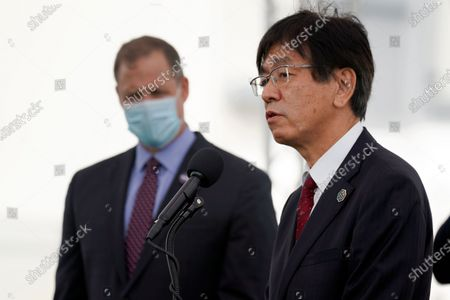 Hiroshi Sasaki, right, vice president and director general, Japanese Space Agency Human Spaceflight Technology Directorate speaks as NASA administrator Jim Bridenstine, left, listens during a news conference at the Kennedy Space Center in Cape Canaveral, Fla