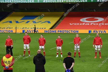 Leigh Halfpenny, Will Rowlands, Jonathan Davies, Gareth Davies, Shane Lewis-Hughes and Alun Wyn Jones of Wales sing the anthem.