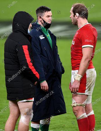 Jonathan Davies and Alun Wyn Jones of Wales with Jonathan Sexton of Ireland.