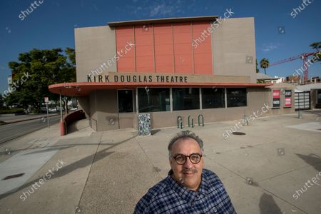 """Stock Photo of Writer Luis Alfaro is photographed outside the Kirk Douglas Theatre in Culver City. In an effort to adapt live theater for the COVID era, Center Theatre Group has transformed the Kirk Douglas Theatre into a digital studio, and is launching virtually produced readings of """"The Greek Trilogy of Luis Alfaro."""" Writer of the production Alfaro is known for revising Greek Plays to have an emphasis on Latino Culture. (Mel Melcon / Los Angeles Times)"""