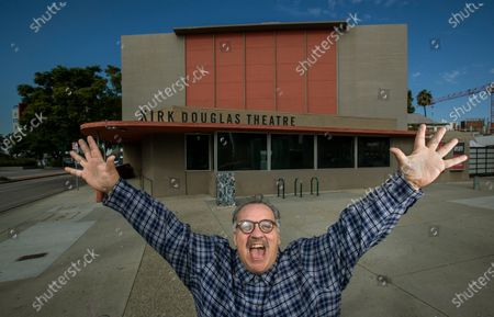 """Stock Picture of Writer Luis Alfaro is photographed outside the Kirk Douglas Theatre in Culver City. In an effort to adapt live theater for the COVID era, Center Theatre Group has transformed the Kirk Douglas Theatre into a digital studio, and is launching virtually produced readings of """"The Greek Trilogy of Luis Alfaro."""" Writer of the production Alfaro is known for revising Greek Plays to have an emphasis on Latino Culture. (Mel Melcon / Los Angeles Times)"""