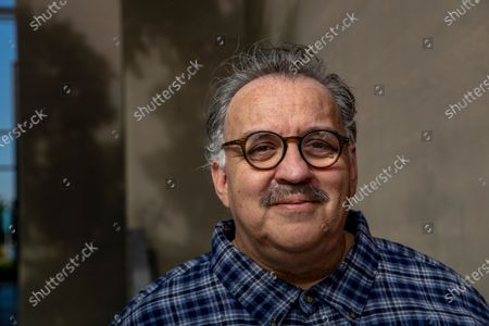"""Writer Luis Alfaro is photographed outside the Kirk Douglas Theatre in Culver City. In an effort to adapt live theater for the COVID era, Center Theatre Group has transformed the Kirk Douglas Theatre into a digital studio, and is launching virtually produced readings of """"The Greek Trilogy of Luis Alfaro."""" Writer of the production Alfaro is known for revising Greek Plays to have an emphasis on Latino Culture. (Mel Melcon / Los Angeles Times)"""