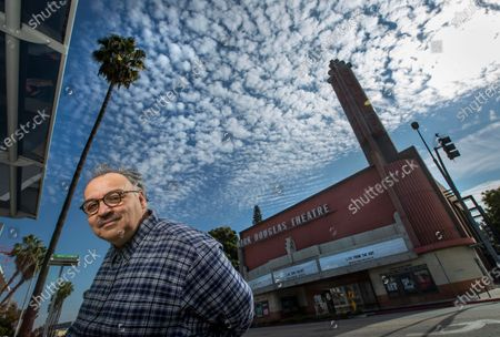 """Writer Luis Alfaro is photographed in front of the Kirk Douglas Theatre in Culver City. In an effort to adapt live theater for the COVID era, Center Theatre Group has transformed the Kirk Douglas Theatre into a digital studio, and is launching virtually produced readings of """"The Greek Trilogy of Luis Alfaro."""" Writer of the production Alfaro is known for revising Greek Plays to have an emphasis on Latino Culture. (Mel Melcon / Los Angeles Times)"""