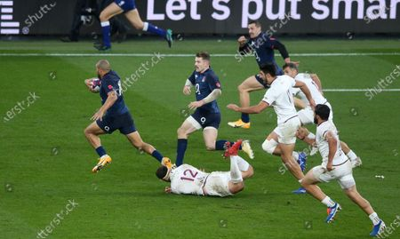 Jonathan Joseph of England beats Merab Sharikadze (Captain) of Georgia's tackle to set up an  Elliot Daly of England (2nd R) try but is injured in the process