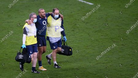 Jonathan Joseph of England leaves the field with an injury