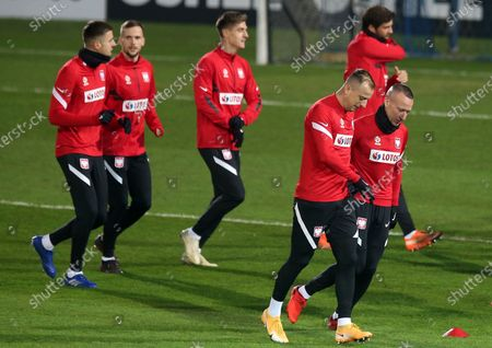 Polish national soccer team players Jacek Goralski (R) and Kamil Grosicki (2R) warm-up during their team's training session in Chorzow, Poland, 13 November 2020. Poland will face Italy in their UEFA Nations League soccer match on 15 November 2020 in Reggio Emilia, Itlay.