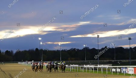 Turanga Leela and Stevie Donohoe [left] wins the Read Katie Walsh On Betway Insider Handicap at Wolverhampton against evening skies.