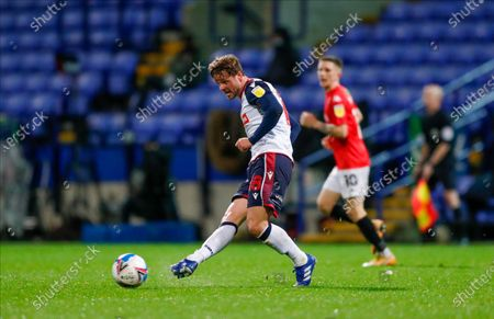 Bolton Wanderers midfielder Brandon Comley (8)  during the EFL Sky Bet League 2 match between Bolton Wanderers and Salford City at the University of  Bolton Stadium, Bolton