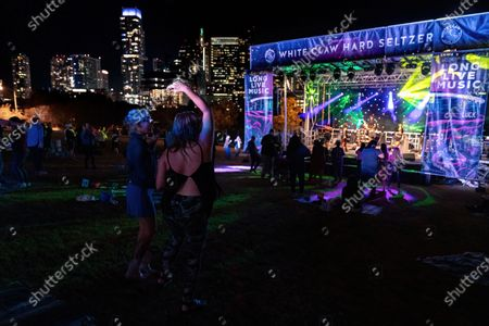 Socially distanced fans attend a Long Live Music event featuring Big Freedia on the lawn at the Long Center
