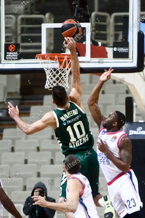 Stock Image of James Anderson (R) of Anadolu Efes in action against Ioannis Papapetrou (L) of Panathinaikos during the Eurolague basketball match between Panathinaikos OPAP Athens and Anadolu Efes at the OAKA Stadium in Piraeus, Greece, 13 November 2020.