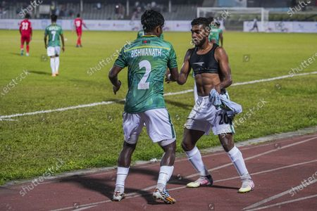 Bangladeshi Mahbubur Rahman (R) and Bishwanath Ghosh (L) celebrate a goal during the First FIFA friendly match between Bangladesh and Nepal at Bangabandhu National Stadium in Dhaka. (Final score; Bangladesh 2:0 Nepal)