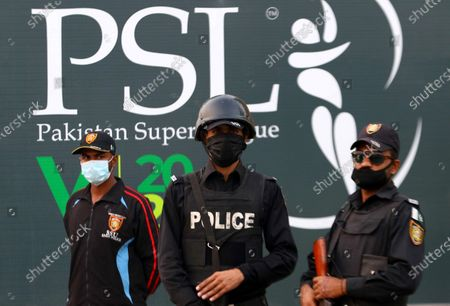 Pakistani security officials stands guard outside the National Stadium during Pakistan Super League (PSL) T20 series matchs when the playoffs resume on Saturday after an eight-month pandemic-enforced break in Karachi, Pakistan, 13 Novemebr 2020.The fifth PSL was postponed on March 17 after England batsman Alex Hales was suspected of contracting COVID-19 just an hour before the playoffs. PSL 2020 play-offs will be played at the National Stadium in Karachi from November 14 with the final scheduled for November 17.