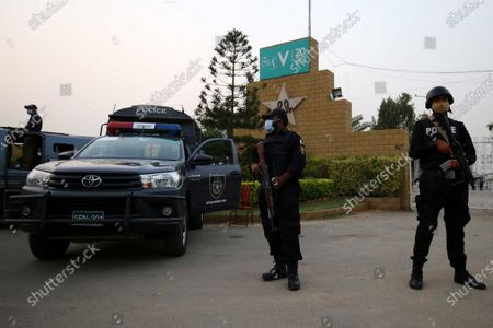 A Pakistani security official stands guard outside the National Stadium during Pakistan Super League (PSL) T20 series matchs when the playoffs resume on Saturday after an eight-month pandemic-enforced break in Karachi, Pakistan, 13 Novemebr 2020.The fifth PSL was postponed on March 17 after England batsman Alex Hales was suspected of contracting COVID-19 just an hour before the playoffs. PSL 2020 play-offs will be played at the National Stadium in Karachi from November 14 with the final scheduled for November 17.