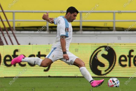 Uruguay's Luis Suarez takes a shot during a qualifying soccer match for the FIFA World Cup Qatar 2022 against Colombia at the Metropolitano stadium in Barranquilla, Colombia