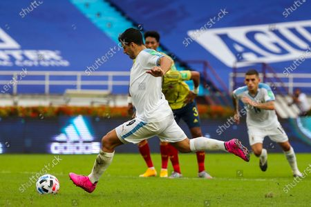 Uruguay's Luis Suarez scores from the penalty spot his side's second goal against Colombia during a qualifying soccer match for the FIFA World Cup Qatar 2022 at the Metropolitano stadium in Barranquilla, Colombia