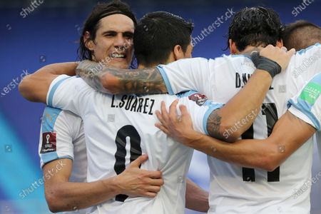 Uruguay's Edinson Cavani, left, embrace teammate Luis Suarez after he scored from the penalty spot his side's second goal against Colombia during a qualifying soccer match for the FIFA World Cup Qatar 2022 at the Metropolitano stadium in Barranquilla, Colombia