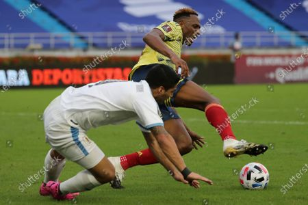Stock Image of Colombia's Yerry Mina, back, and Uruguay's Luis Suarez vie for the ball during a qualifying soccer match for the FIFA World Cup Qatar 2022 at the Metropolitano stadium in Barranquilla, Colombia