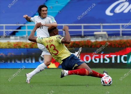 Edinson Cavani (L) of Uruguay scores next to Yerry Mina of Colombia during the South American qualifiers soccer match to Qatar 2022 World Cup between Colombia and Uruguay at Metropolitano in Barranquilla, Colombia, 13 November 2020.