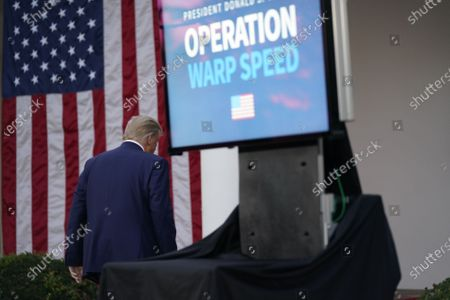 United States President Donald J. Trump departs after delivering an update on Operation Warp Speed during a press conference in the Rose Garden of the White House in Washington, DC. OWS is a public private partnership, initiated by the Trump administration, to facilitate and accelerate the development, manufacturing, and distribution of COVID-19 vaccines, therapeutics, and diagnostics.