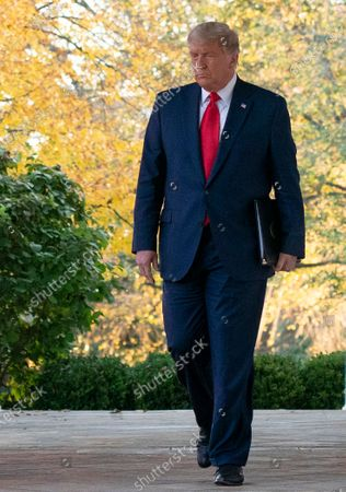 United States President Donald J. Trump walks on the Colonnade from the Oval Office to the Rose Garden to deliver an update on Operation Warp Speed during a press conference at the White House in Washington, DC. OWS is a public private partnership, initiated by the Trump administration, to facilitate and accelerate the development, manufacturing, and distribution of COVID-19 vaccines, therapeutics, and diagnostics.