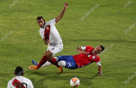Peru's Miguel Trauco, left, and Chile's Fabián Orellana battle for the ball during a qualifying soccer match for the FIFA World Cup Qatar 2022 in Santiago, Chile