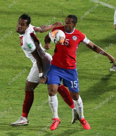 Peru's Renato Tapia, left, and Chile's Jean Beausejour battle for the ball during a qualifying soccer match for the FIFA World Cup Qatar 2022 in Santiago, Chile