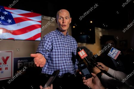 Senator Rick Scott (R-GA) speaks to the press after a rally for Senators Kelly Loeffler and David Perdue re-election campaigns as they compete in January run offs