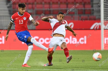 Chile's Erick Pulgar (L) in action against Peru's Yoshimar Yotun, during a match for the South American qualifiers for the Qatar 2022 World Cup between Chile and Peru, at the National Stadium in Santiago, Chile, 13 November 2020.