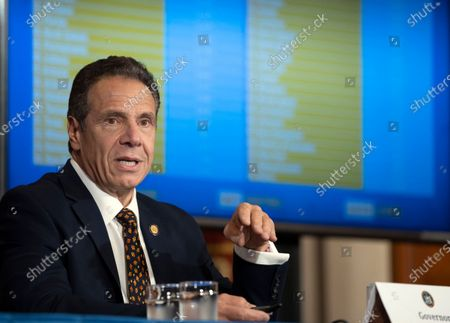 "Stock Picture of In this Oct. 21, 2020, photo provided by the Office of Governor Andrew M. Cuomo, Gov. Cuomo provides a coronavirus update during a news conference in the Red Room at the State Capitol in Albany, N.Y. Cuomo said, that six northeast U.S. governors are having an ""emergency summit"" on COVID-19 this coming weekend as the coronavirus continues to spread throughout the region"