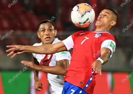 Alexis Sanchez of Chile in action against Yoshimar Yotun (L) of Peru during the South America's Qatar 2022 World Cup Qualifiers soccer match between Chile and Peru, at the National Stadium in Santiago, Chile, 13 November 2020.