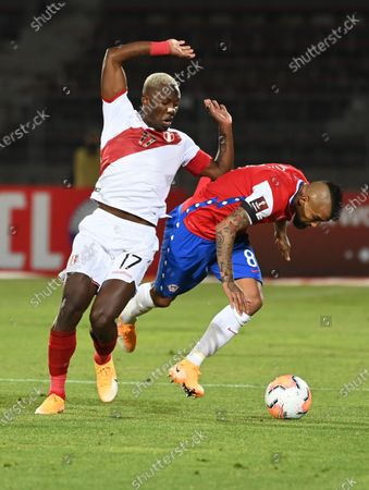 CArturo Vidal of Chile (R) in action against Luis Advincula (L) of Peru during the South America's Qatar 2022 World Cup Qualifiers soccer match between Chile and Peru, at the National Stadium in Santiago, Chile, 13 November 2020.