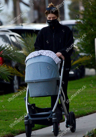 Stock Image of Exclusive - Katherine Schwarzenegger wearing a mask that says 'I am a voter' takes daughter Lyla Maria Pratt for an late afternoon walk in Santa Monica