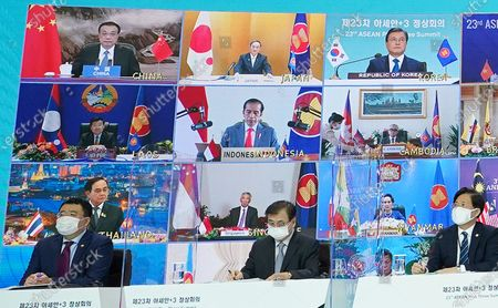 South Korean President Moon Jae-in (R, top of screen) attends a virtual session of the ASEAN Plus Three Summit from Cheong Wa Dae in Seoul, South Korea, 14 November 2020, joined by Japanese Prime Minister Yoshihide Suga (C, top of screen) and Chinese Premier Li Keqiang (L, top of screen).