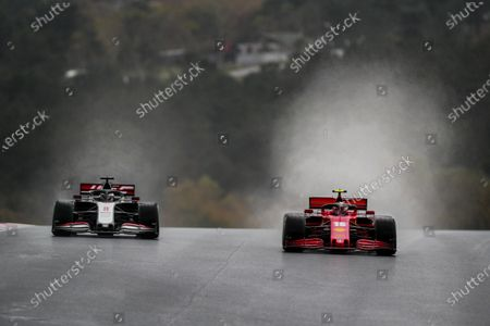 Charles Leclerc, Ferrari SF1000, leads Romain Grosjean, Haas VF-20 during the 2020 Formula One Turkish Grand Prix