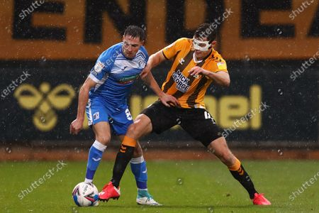 Paul Digby of Cambridge United and Mike Jones of Barrow - Cambridge United v Barrow, Sky Bet League Two, Abbey Stadium, Cambridge, UK - 14th November 2020