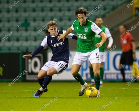 Joe Newell of Hibernian challenges for the ball with Finlay Robertson of Dundee; Easter Road, Edinburgh, Scotland; Scottish League Cup Football, Hibernian versus Dundee FC.
