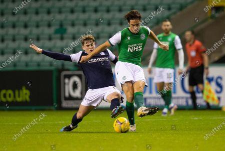 Joe Newell of Hibernianholds off the challenge from Finlay Robertson of Dundee; Easter Road, Edinburgh, Scotland; Scottish League Cup Football, Hibernian versus Dundee FC.
